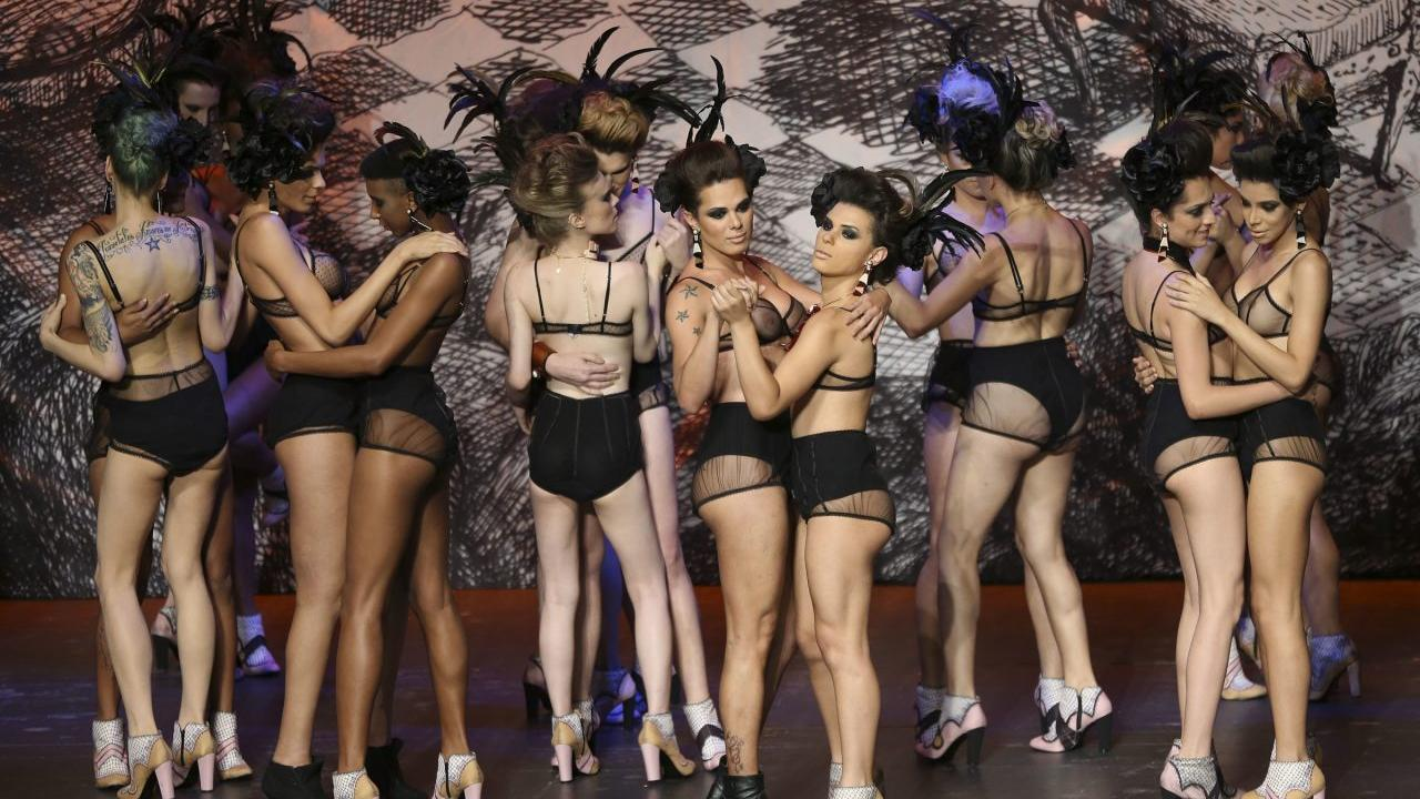 EDS NOTE NUDITY - Transsexual models dance after presenting creation from the Ronaldo Fraga collection during the Sao Paulo Fashion Week in Sao Paulo, Brazil, Wednesday, Oct. 26, 2016. Fashion Stylist Ronaldo Fraga hired 28 transsexuals for his show at the Fashion Week. He said It was a political act to face prejudice and violence against transsexuals and transgender people. (AP Photo/Andre Penner)