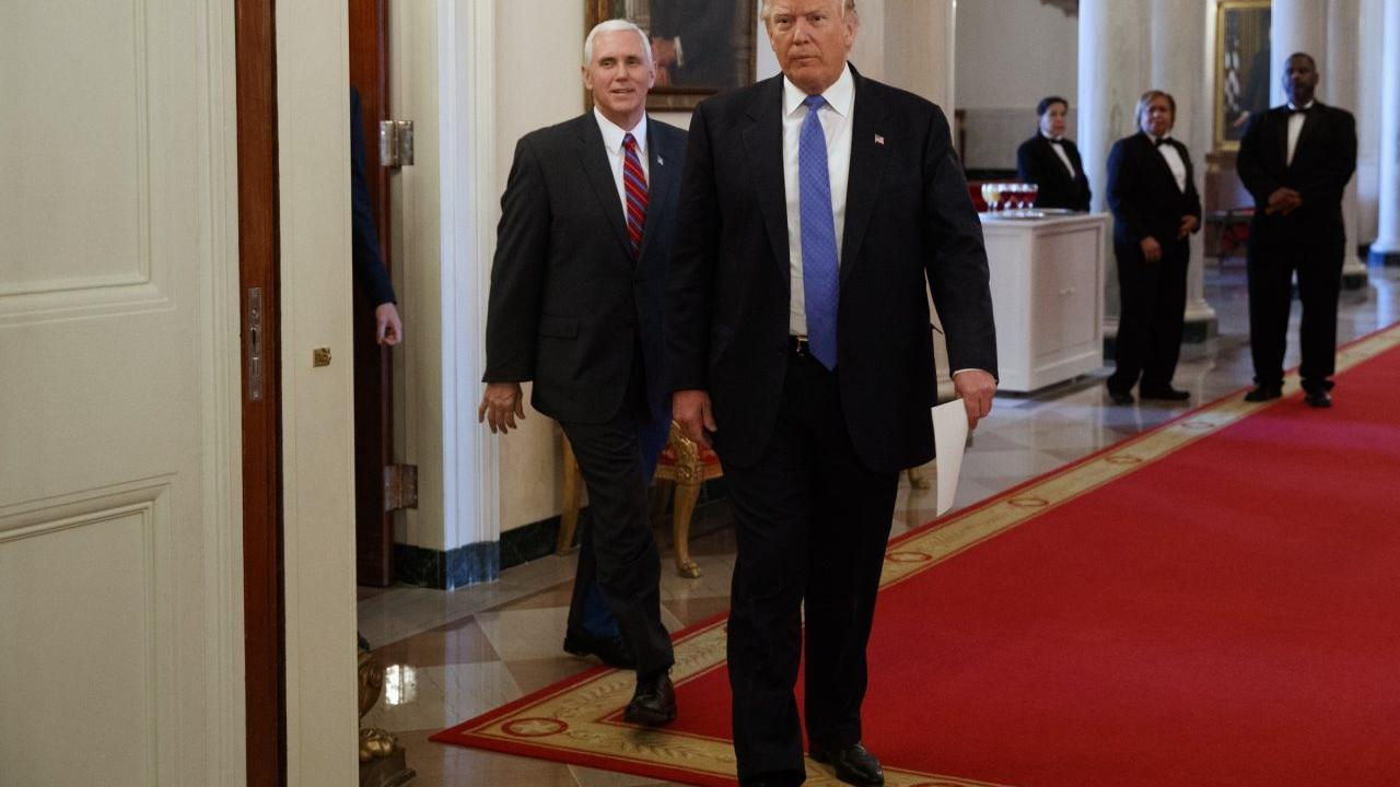 President Donald Trump, followed by Vice President Mike Pence, arrives for a meeting with manufacturing executives at the White House in Washington, Thursday, Feb. 23, 2017. (AP Photo/Evan Vucci)