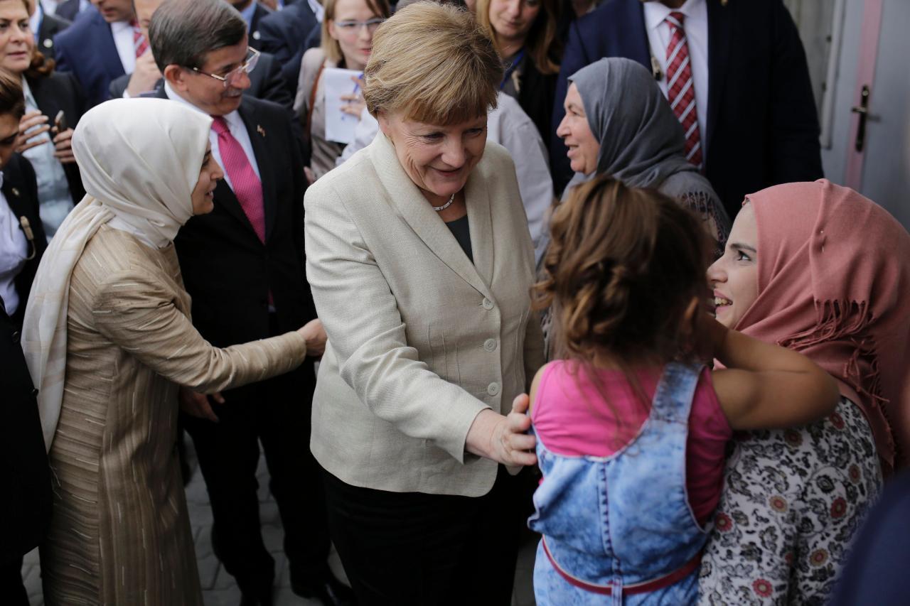 Merkel ja immigrandid